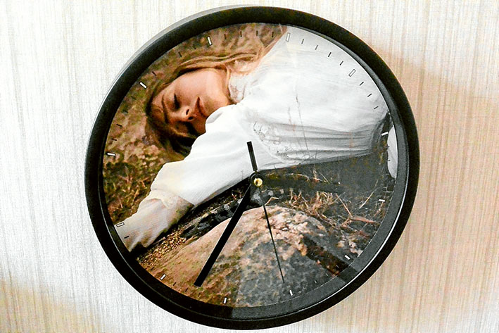"""Pictures: (from top) A clock adorns the walls of the historic Mulberry Hill mansion, where the National Trust is currently exhibiting Return to Hanging Rock; homestead curator Cara Simpson at the entrance to the perfectly preserved manor; and a typewriter in Lady Joan Lindsay's """"scribbling room."""""""